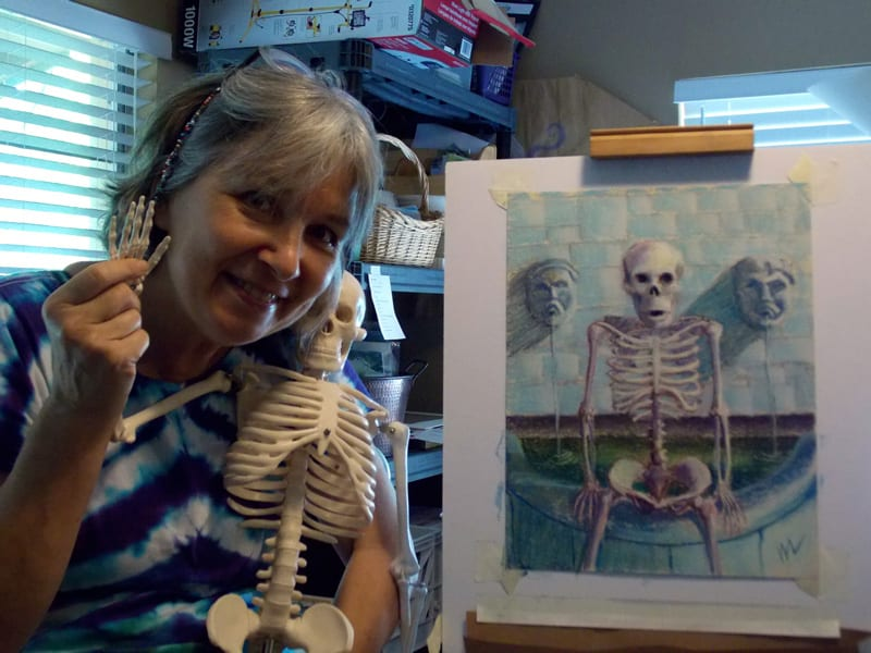 picture of me with a skeleton and a skelly painting