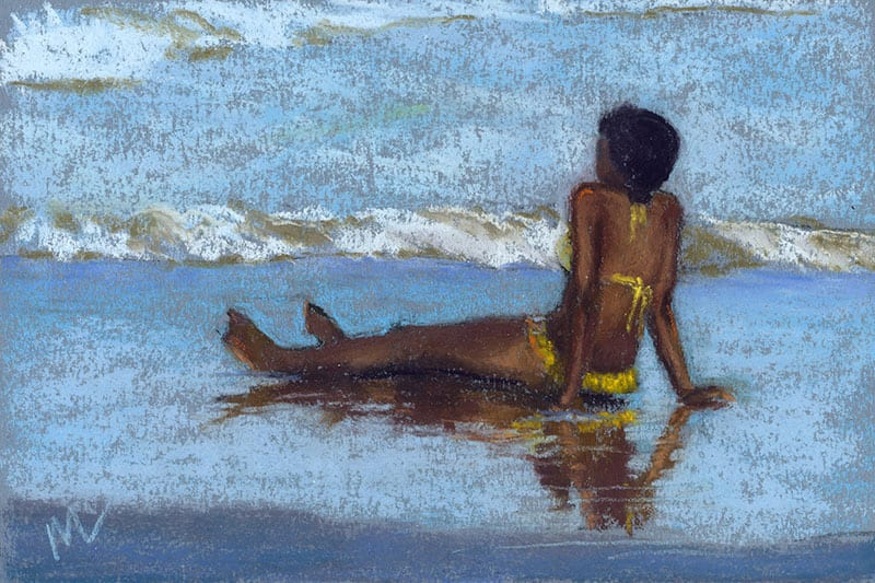 woman sitting on the beach in a yellow bikini