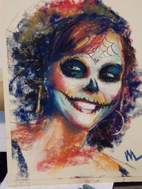 pastel portrait commission of a woman with sugar skull make up