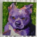 acrylic painting of a pit bull dog face in purple