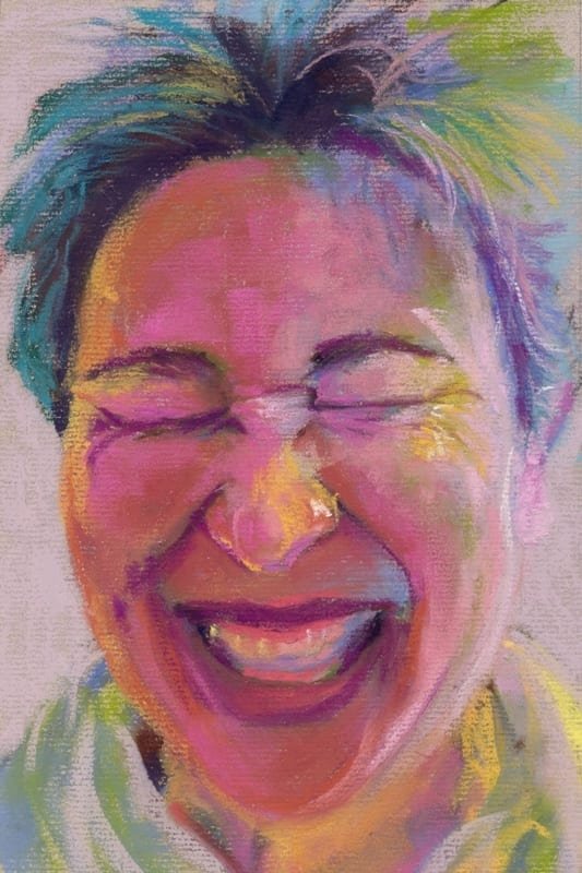 pastel portrait of a laughing woman