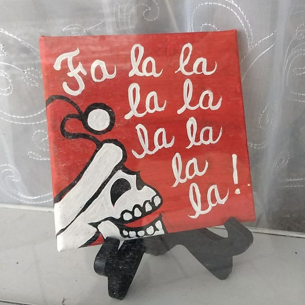 Falala skeleton with a santa hat painting in red, black and white