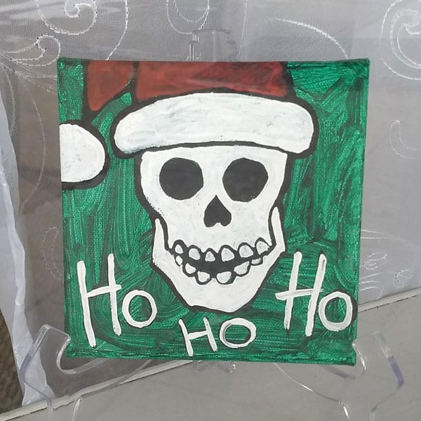 skeleton with a santa hat ho ho ho christmas painting in acrylic