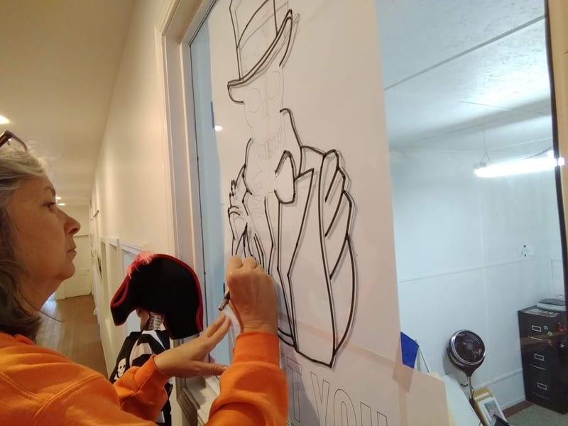 making a skeleton art window painting