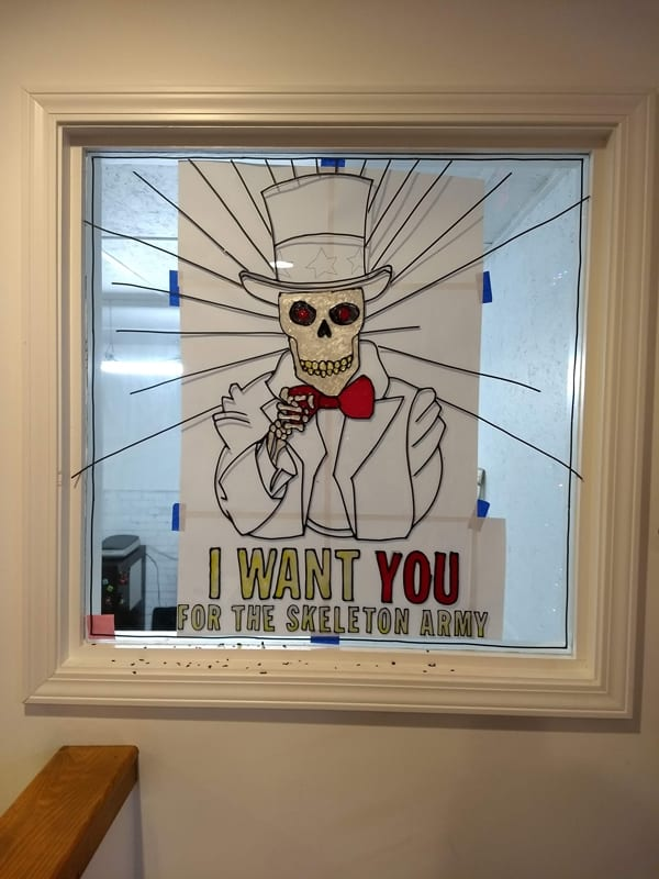 skeleton art painted window