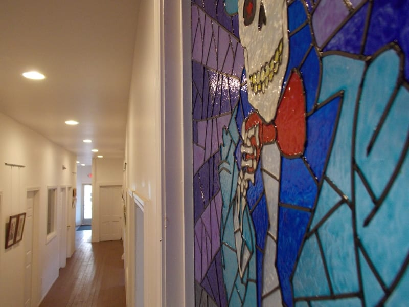 looking down the hall from skelly window art