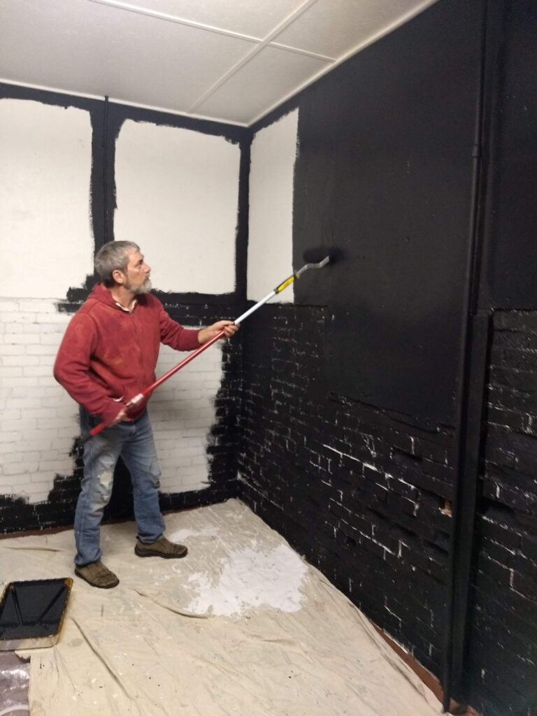 Steve painting the gallery.