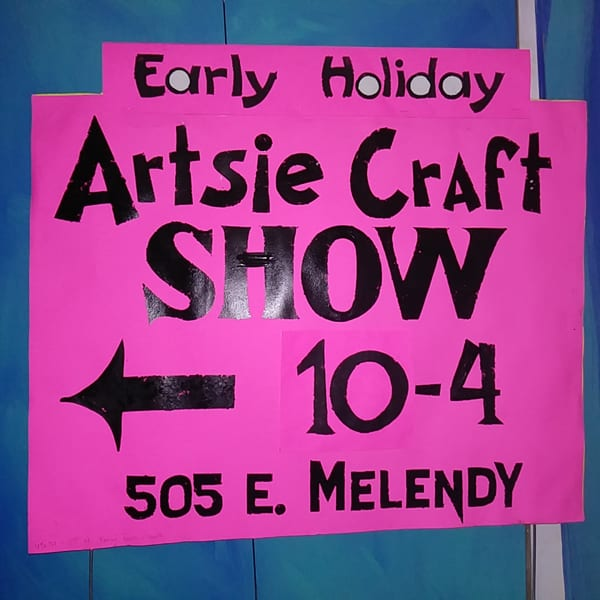large pink signs for the Early Holiday Artsie Craft Show